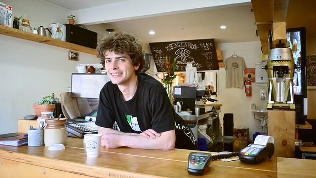 young teenager working at a coffee shop